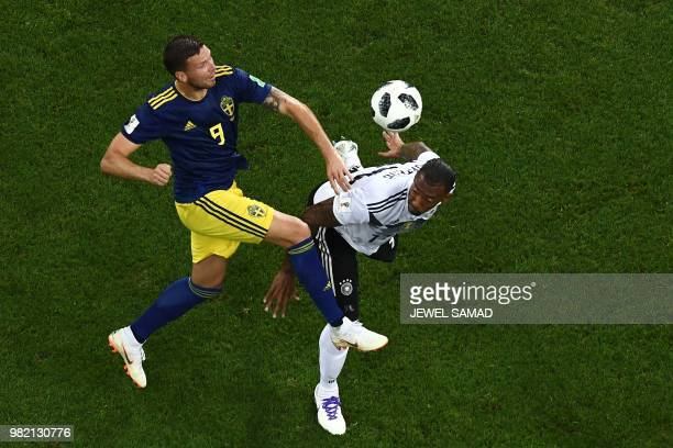 Sweden's forward Marcus Berg vies for the header with Germany's defender Jerome Boateng during the Russia 2018 World Cup Group F football match...