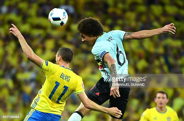 TOPSHOT Sweden's forward Marcus Berg vies with Belgium's midfielder Axel Witsel during the Euro 2016 group E football match between Sweden and...