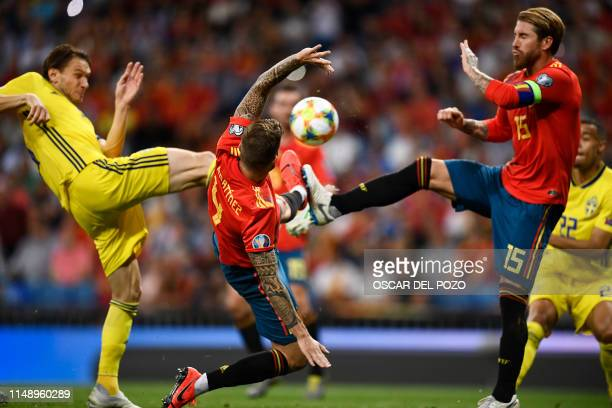 Sweden's forward Marcus Berg vies with Spain's defender Sergio Ramos and Spain's defender Inigo Martinez during the UEFA Euro 2020 group F qualifying...