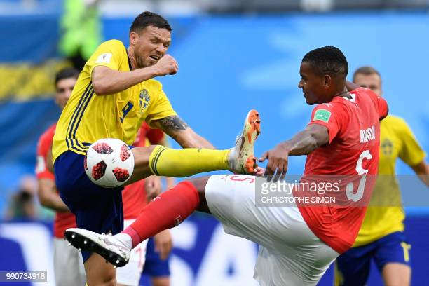 Sweden's forward Marcus Berg vies with Switzerland's defender Manuel Akanji during the Russia 2018 World Cup round of 16 football match between...