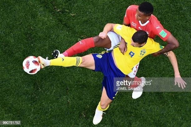 TOPSHOT Sweden's forward Marcus Berg vies with Switzerland's defender Manuel Akanji during the Russia 2018 World Cup round of 16 football match...