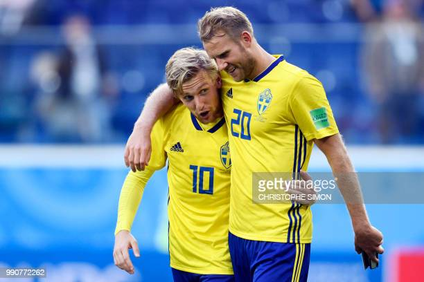 Sweden's forward Ola Toivonen and Sweden's midfielder Emil Forsberg celebrate at the end of the Russia 2018 World Cup round of 16 football match...