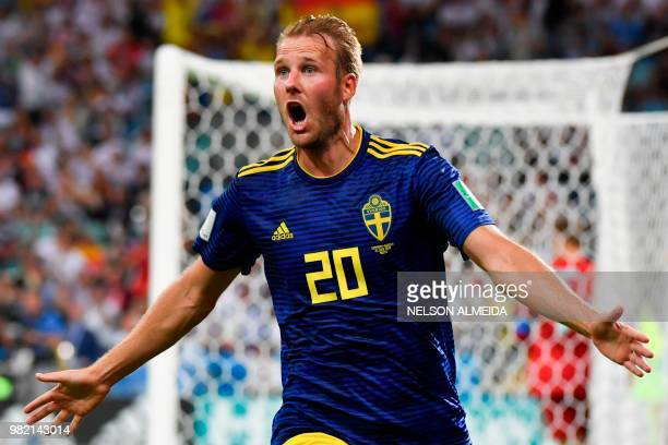 TOPSHOT Sweden's forward Ola Toivonen celebrates scoring the opening goal during the Russia 2018 World Cup Group F football match between Germany and...