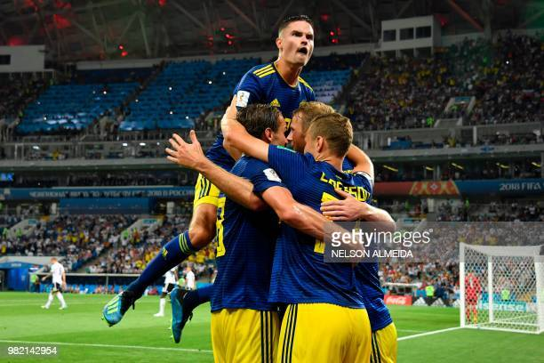 TOPSHOT Sweden's forward Ola Toivonen celebrates scoring the opening goal with his teammates during the Russia 2018 World Cup Group F football match...