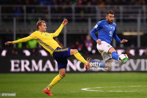 Sweden's forward Ola Toivonen fights for the ball with Italy's defender Andrea Barzagli during the FIFA World Cup 2018 qualification football match...