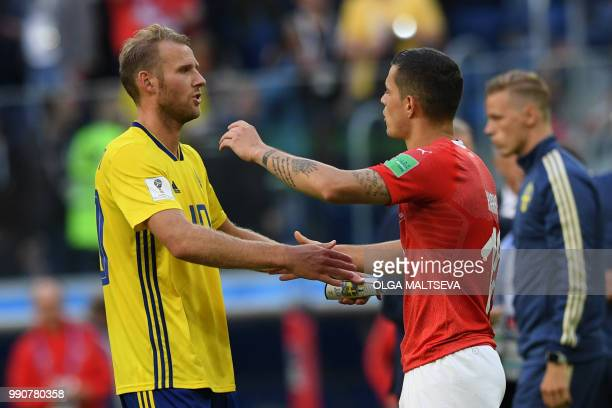 Sweden's forward Ola Toivonen shakes hands with Switzerland's midfielder Granit Xhaka after the Russia 2018 World Cup round of 16 football match...