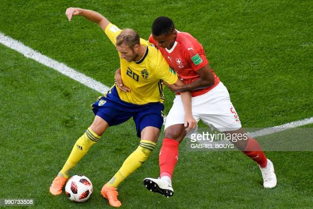 TOPSHOT Sweden's forward Ola Toivonen vies with Switzerland's defender Manuel Akanji during the Russia 2018 World Cup round of 16 football match...