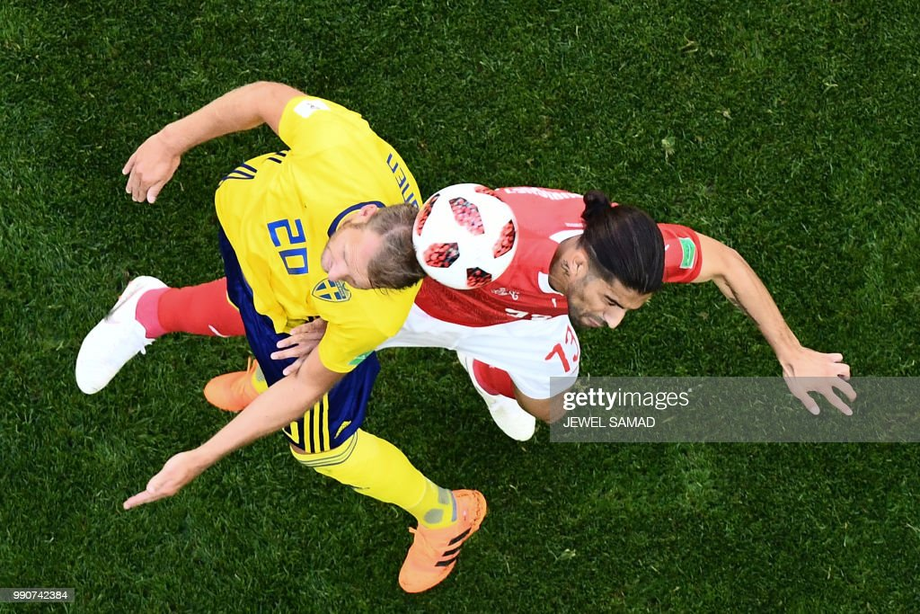 TOPSHOT - Sweden's forward Ola Toivonen (L) vies with Switzerland's defender Ricardo Rodriguez during the Russia 2018 World Cup round of 16 football match between Sweden and Switzerland at the Saint Petersburg Stadium in Saint Petersburg on July 3, 2018. (Photo by Jewel SAMAD / AFP) / RESTRICTED