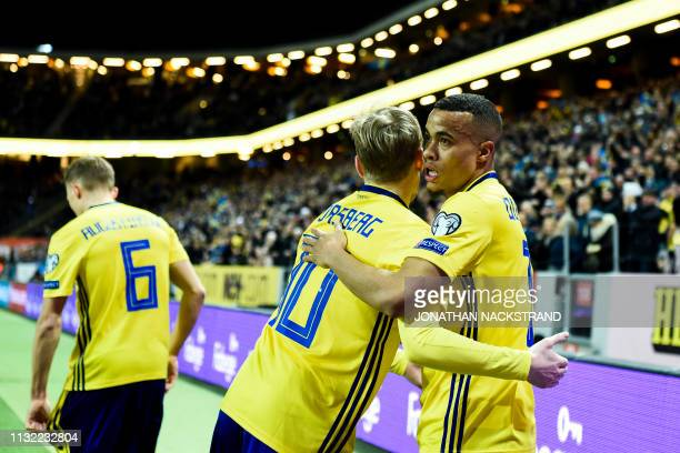 Sweden's forward Robin Quaison celebrates with his teammates after scoring during the Euro 2020 football 1st round Groupe F qualification match...