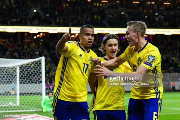 Sweden's forward Robin Quaison celebrates with his teammates Sweden's midfielder Kristoffer Olsson and Sweden's defender Ludwig Augustinsson after...