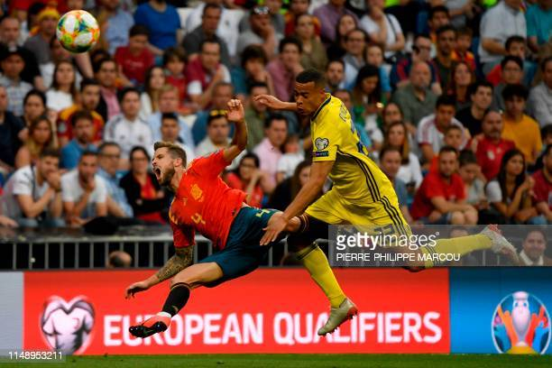 Sweden's forward Robin Quaison challenges Spain's defender Inigo Martinez during the UEFA Euro 2020 group F qualifying football match between Spain...