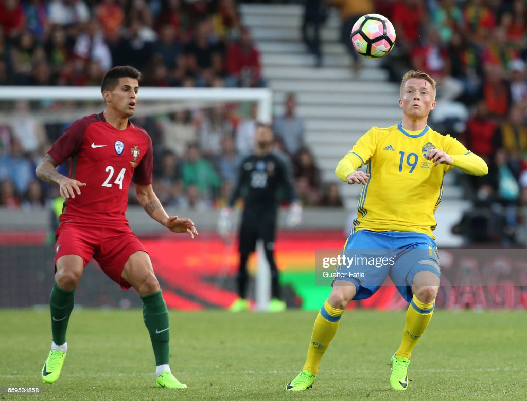 Sweden's forward Sam Larsson (R) with Portugal's defender Joao Cancelo (L) in action during the International Friendly match between Portugal and Sweden at Estadio dos Barreiros on March 28, 2017 in Funchal (Madeira), Portugal.