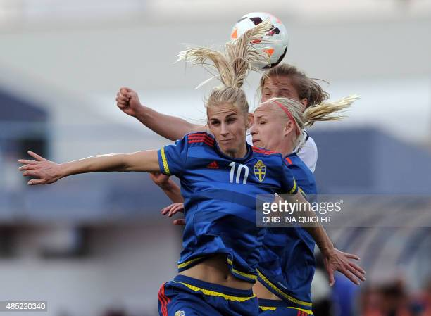 Sweden's forward Sofia Jakobsson and Sweden's midfielder Caroline Seger vie with Germany's midfielder Melanie Leupolz during the Algarve Cup football...