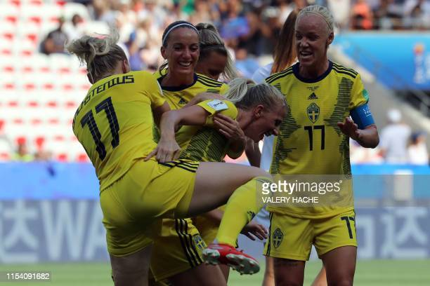 Sweden's forward Sofia Jakobsson is congratulated by teammates after scoring a goal during the France 2019 Women's World Cup third place final...
