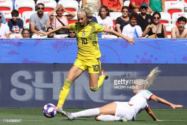 Sweden's forward Sofia Jakobsson vies with England's defender Alex Greenwood during the France 2019 Women's World Cup third place final football...