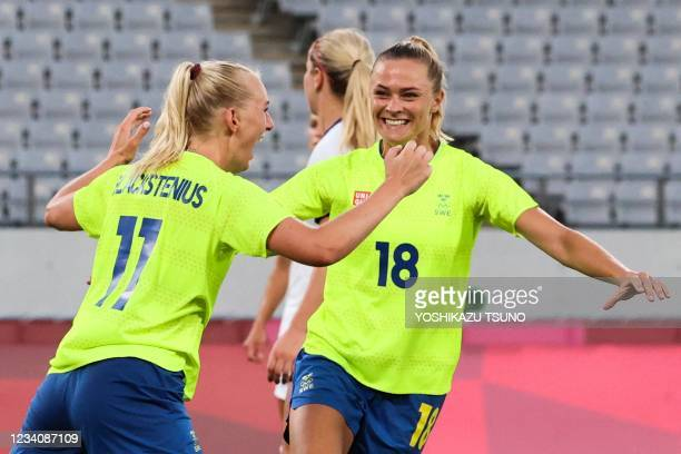Sweden's forward Stina Blackstenius celebrates with Sweden's forward Fridolina Rolfo after scoring the second goal during the Tokyo 2020 Olympic...