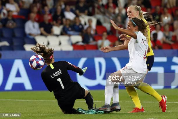 Sweden's forward Stina Blackstenius vies with Canada's defender Shelina Zadorsky and Canada's goalkeeper Stephanie Labbe on her way to score a goal...