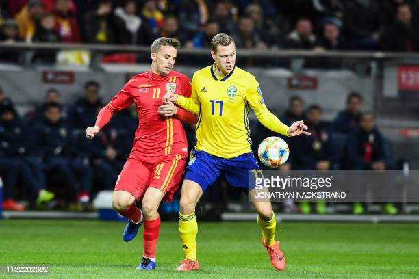 Sweden's forward Viktor Claesson and Romania's defender Nicusor Silviu Bancu vie for the ball during the Euro 2020 football 1st round Groupe F...