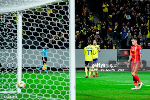 Sweden's forward Viktor Claesson celebrates with his teammate Sweden's forward Robin Quaison after scoring during the Euro 2020 football 1st round...