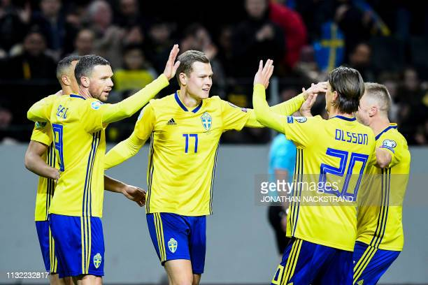 Sweden's forward Viktor Claesson celebrates with his teammates after scoring during the Euro 2020 football 1st round Groupe F qualification match...
