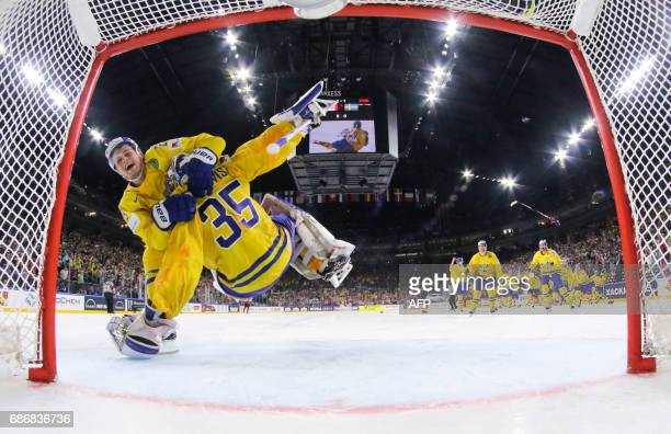 Sweden´s forward William Nylander jumps at Sweden´s goalkeeper Henrik Lundqvist in celebrations after winning the penalty shot out the IIHF Ice...