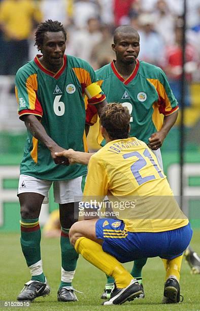 Sweden's forward Zlatan Ibrahimovic congratulates Senegal's team captain and defender Aliou Cisse flanked by defender Omar Daf after Senegal...