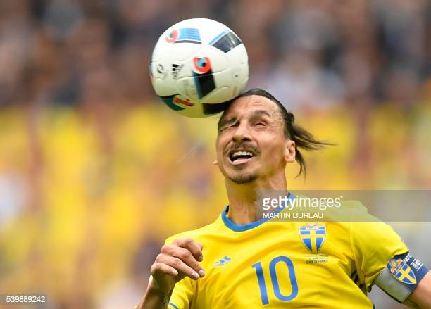 TOPSHOT Sweden's forward Zlatan Ibrahimovic heads the ball during the Euro 2016 group E football match between Ireland and Sweden at the Stade de...
