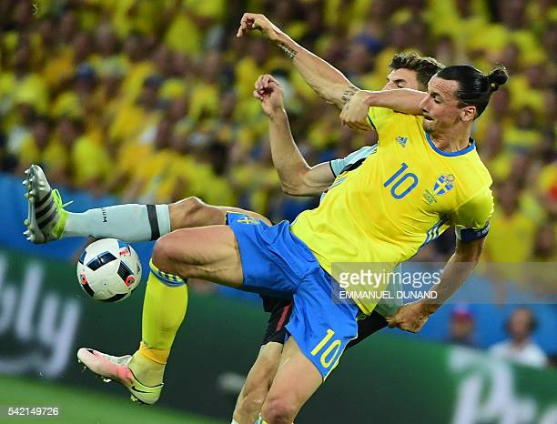 TOPSHOT Sweden's forward Zlatan Ibrahimovic vies with Belgium's defender Thomas Meunier during the Euro 2016 group E football match between Sweden...