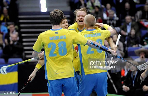 Sweden's Fredrik Djurling Rasmus Sundstedt and Magnus Svensson celebrate the opening 01 score by Svensson during their Worldcup Floorball...