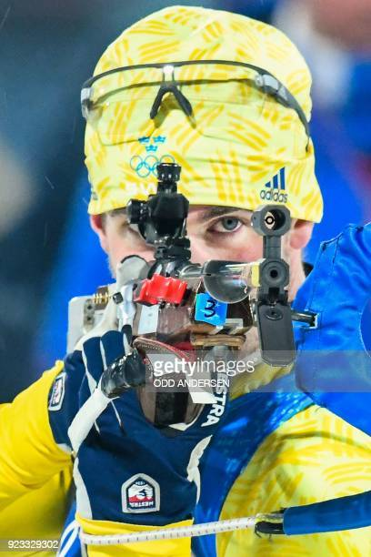 TOPSHOT Sweden's Fredrik Lindstroem competes at the shooting range in the men's 4x75km biathlon event during the Pyeongchang 2018 Winter Olympic...