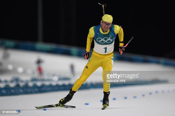 Sweden's Fredrik Lindstroem competes in the men's 20km individual biathlon event during the Pyeongchang 2018 Winter Olympic Games on February 15 in...