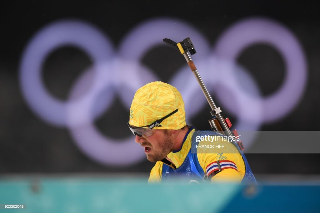 Sweden's Fredrik Lindstroem competes to win team gold in the men's 4x7,5km biathlon relay event during the Pyeongchang 2018 Winter Olympic Games on February 23, 2018, in Pyeongchang. /