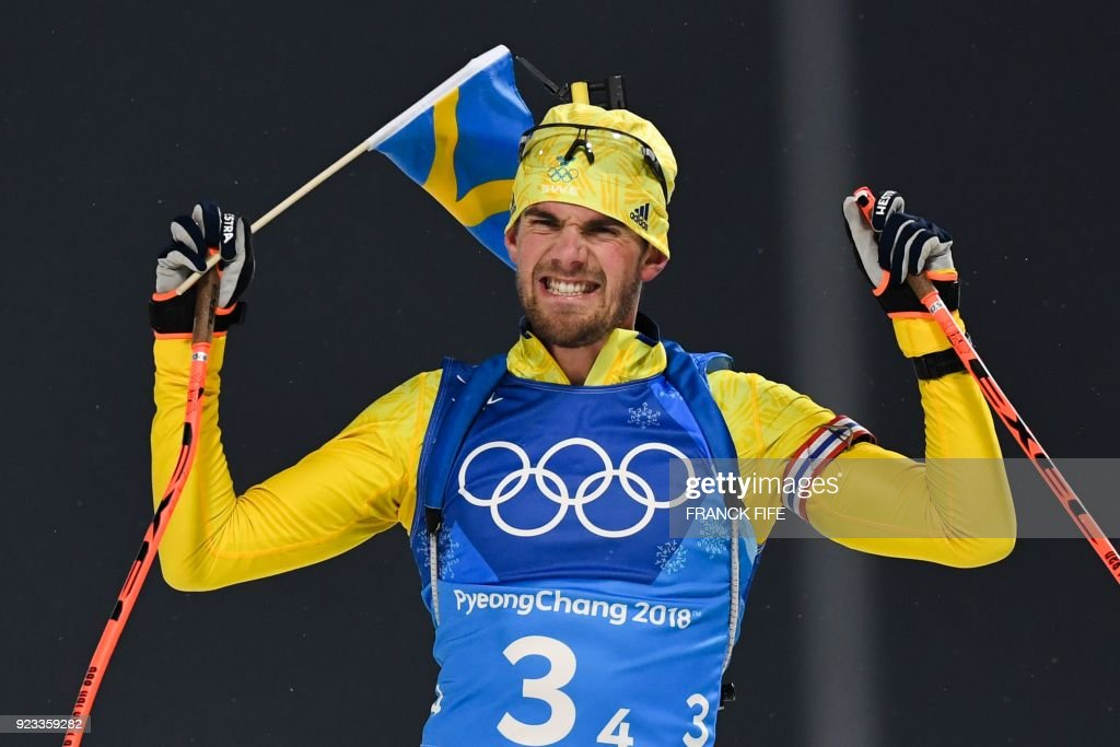 TOPSHOT - Sweden's Fredrik Lindstroem reacts as the team wins gold in the men's 4x7,5km biathlon relay event during the Pyeongchang 2018 Winter Olympic Games on February 23, 2018, in Pyeongchang. /
