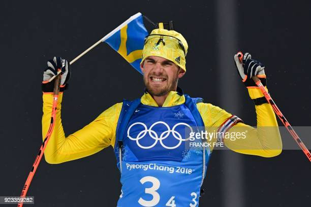 TOPSHOT Sweden's Fredrik Lindstroem reacts as the team wins gold in the men's 4x75km biathlon relay event during the Pyeongchang 2018 Winter Olympic...