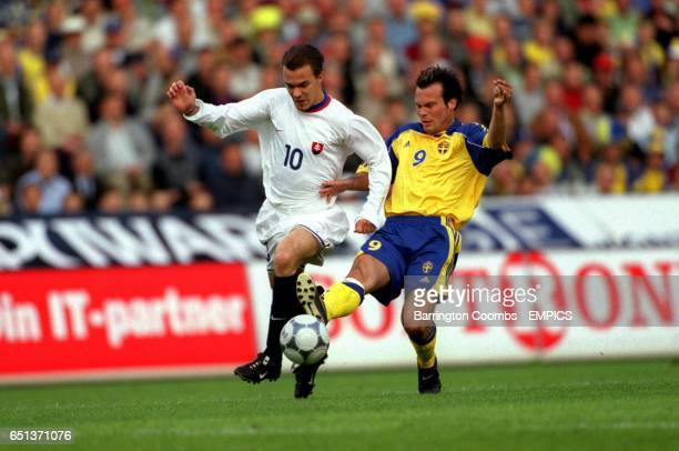 Sweden's Fredrik Ljungberg tackles Slovakia's Szilard Nemeth