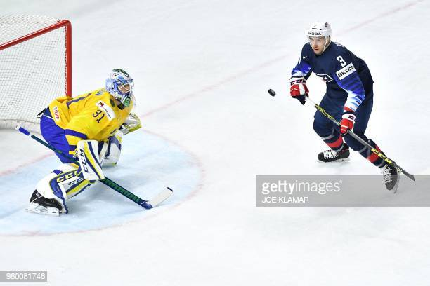 Sweden's goalie Anders Nilsson vies with Nick Bonino during the semifinal match Sweden vs USA of the 2018 IIHF Ice Hockey World Championship at the...