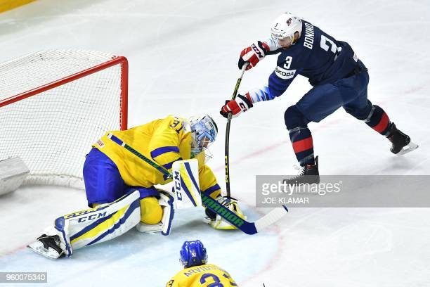 Sweden's goalie Anders Nilsson vies with US Nick Bonino during the semifinal match Sweden vs USA of the 2018 IIHF Ice Hockey World Championship at...