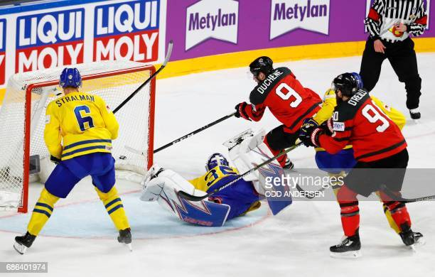 Sweden's goalie Henrik Lundqvist and Canada's Matt Duchene vie during the IIHF Men's World Championship Ice Hockey final match between Canada and...