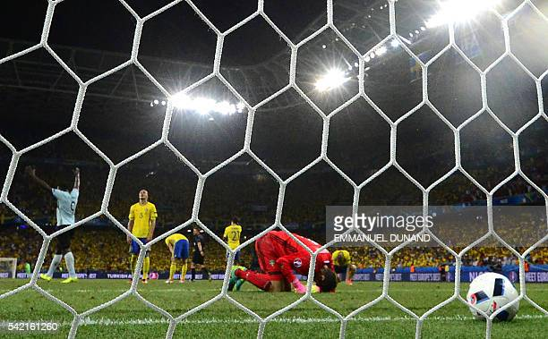 Sweden's goalkeeper Andreas Isaksson bends on the pitch after Belgium's goal during the Euro 2016 group E football match between Sweden and Belgium...