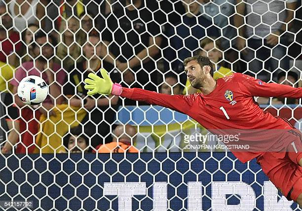 TOPSHOT Sweden's goalkeeper Andreas Isaksson dives to unsuccesfully avoid a goal during the Euro 2016 group E football match between Sweden and...