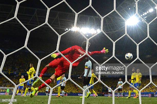Sweden's goalkeeper Andreas Isaksson dives to unsuccesfully avoid a goal during the Euro 2016 group E football match between Sweden and Belgium at...