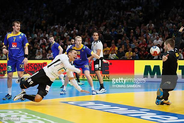 Sweden's goalkeeper Andreas Palicka deflects a shot by Egypt's pivot Mohamed Mamdouh Shebib during the 25th IHF Men's World Championship 2017 Group D...