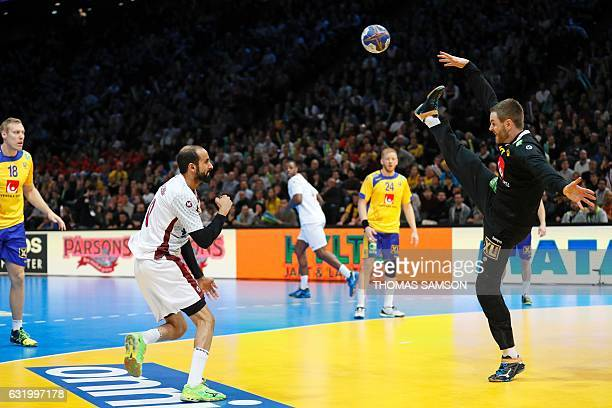 Sweden's goalkeeper Andreas Palicka deflects a shot from Qatar's right wing Abdullah Al Karbi during the 25th IHF Men's World Championship 2017 Group...