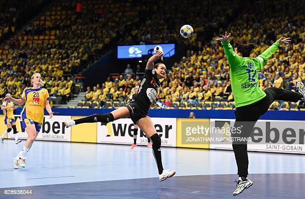 Sweden's goalkeeper Filippa Idehn jumps to stop a throw by Netherlands' Yvette Broch during the Women's European Handball Championship Group I match...