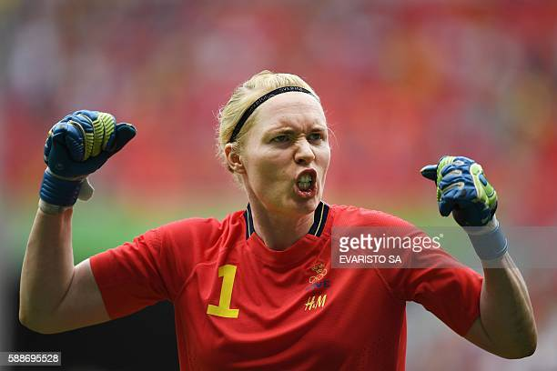 Sweden's goalkeeper Hedvig Lindahl celebrates after defeating USA in their Rio 2016 Olympic Games quarterfinal women's football match at the Mane...