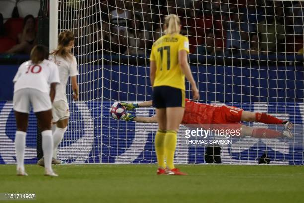 Sweden's goalkeeper Hedvig Lindahl saves a penalty kick during the France 2019 Women's World Cup round of sixteen football match between Sweden and...