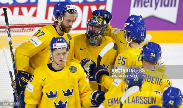 Sweden's goalkeeper Henrik Lundqvist and teammates celebrate during the IIHF Ice Hockey World Championships first round match between Sweden and...