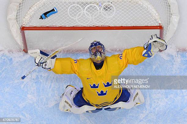 Sweden's goalkeeper Henrik Lundqvist celebrates at the end of the Men's Ice Hockey Semifinal match between Sweden and Finland at the Bolshoy Ice Dome...