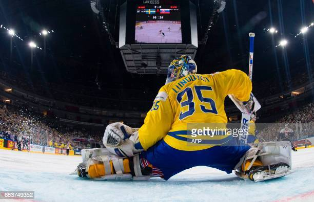 Sweden's goalkeeper Henrik Lundqvist stretches during the IIHF Ice Hockey World Championships first round match between Sweden and Slovakia in...