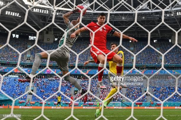 Sweden's goalkeeper Robin Olsen catches the ball as Poland's forward Robert Lewandowski jumps during the UEFA EURO 2020 Group E football match...